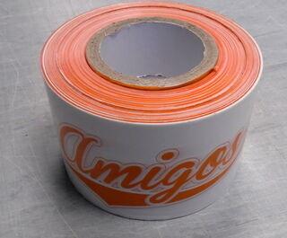Rajoitusnauha logolla Amigos